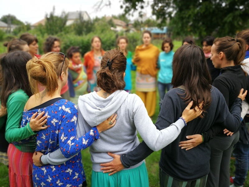 Mothers linking arms in a circle